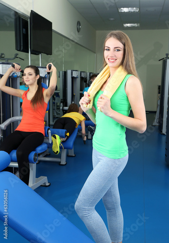 Young beautiful womans in gym