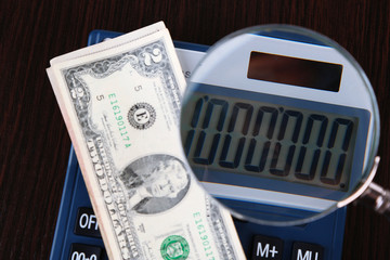 Fraud concept with magnifier and calculator,