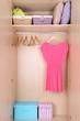 Dress with hangers in wardrobe