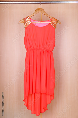 Dress with hangers in wardrobe