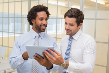Businessmen with digital tablet in office