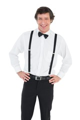 Smiling groom wearing suspenders