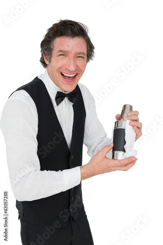 Bartender using cocktail shaker against white background