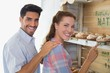 Young couple at the bakery store