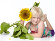 canvas print picture - Cute blond child with sunflower