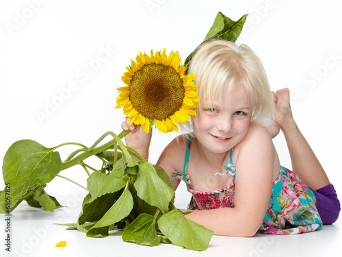 canvas print picture Cute blond child with sunflower