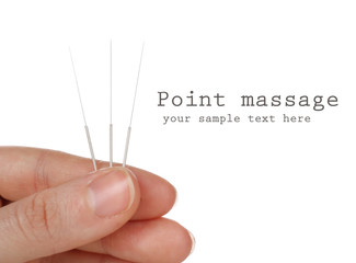 Hand holding needles for acupuncture isolated on white
