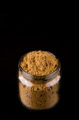 Korma spice powder on black background