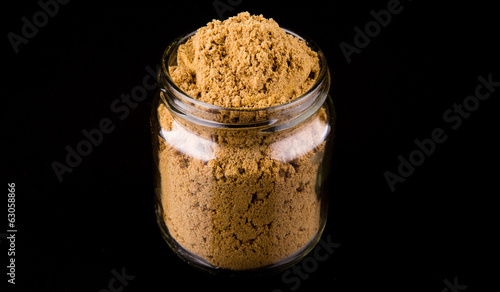 Korma spice powder on black background