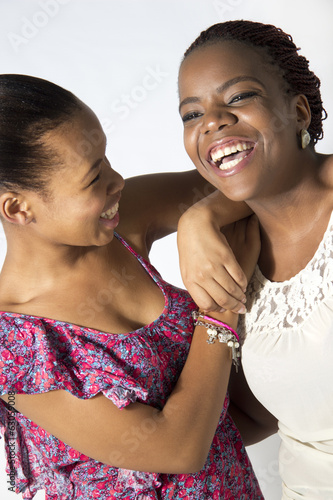Two Black Best Friends laughing and joking