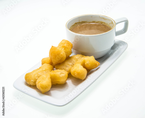Vintage coffee with deep-fried dough stick are popula drink in A