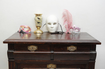 Vintage commode with masks