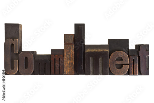 poster of commitment, word written in vintage printing blocks