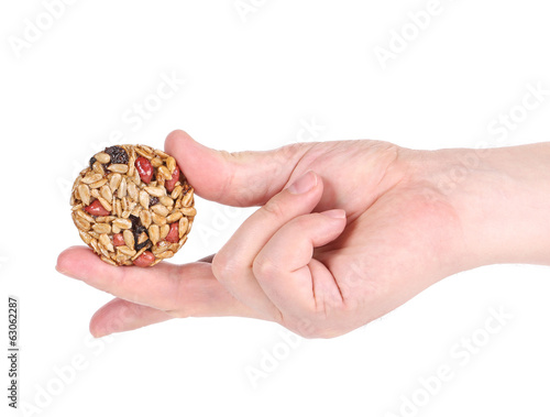 Honey bar with sunflower seed in hand