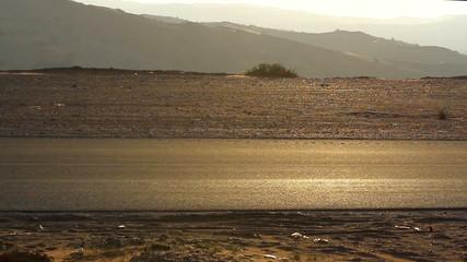 car traveling through the desert,car road through the desert