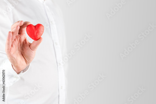 Man holding a small red Valentines heart