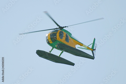 Small patrol helicopter in the sky.