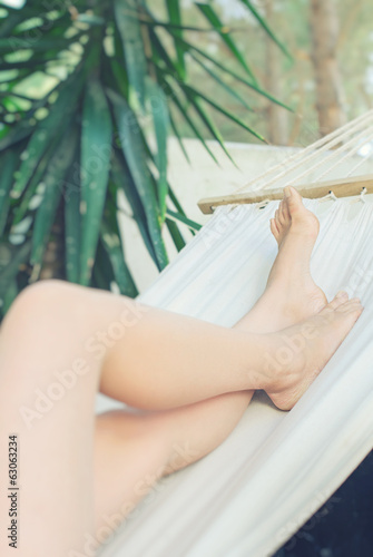 Girl resting in a hammock. Legs.