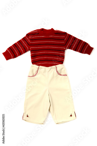 Close up of a baby red striped blouse and yellow pants isolated