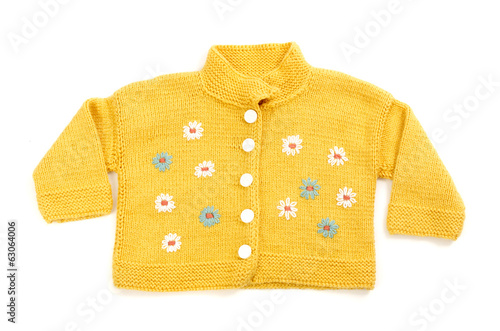 Close up of a baby yellow blouse with colorful flowers isolated