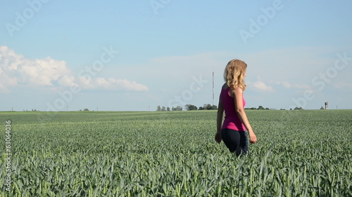 tall blonde woman goes through adult green corn