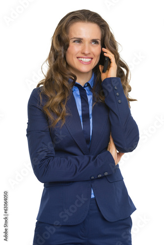 Happy business woman talking cell phone