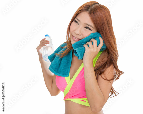 Asian woman with water bottle and towel