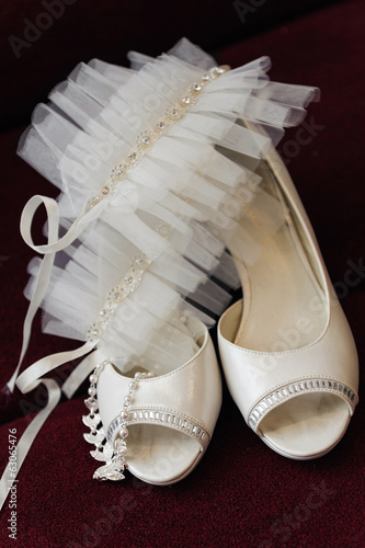 two white bride weddings easy shoes on a dark background