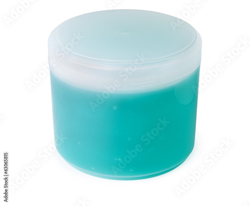 Plastic jar with a green-blue gel soap
