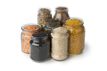 Variety of dried lentils in glass pots