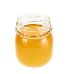 Opened honey jar isolated