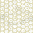 Seamless pattern of white circles painted on beige paper