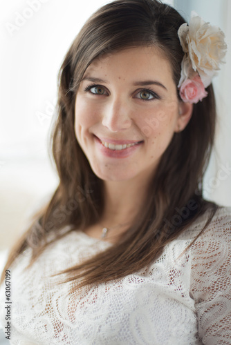 Defocused picture of a romantic woman with pink flowers.