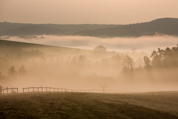 Foggy hills in autumn dawn, Czech republic