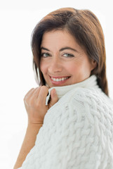 mature lady wrapped in a white wool sweater