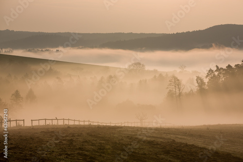 Foggy hills in autumn dawn, Czech republic