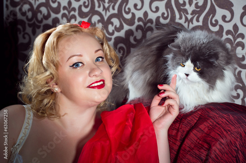 pin up  plus size girl posing with the cat