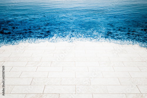 Marble floor being flooded by sea, climate change