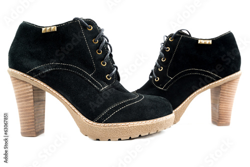 Women's boots with black suede on a white background