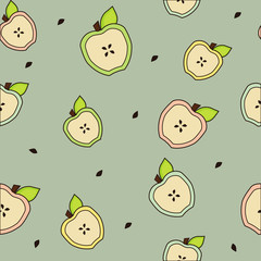 Apple halves with leaves seamless background