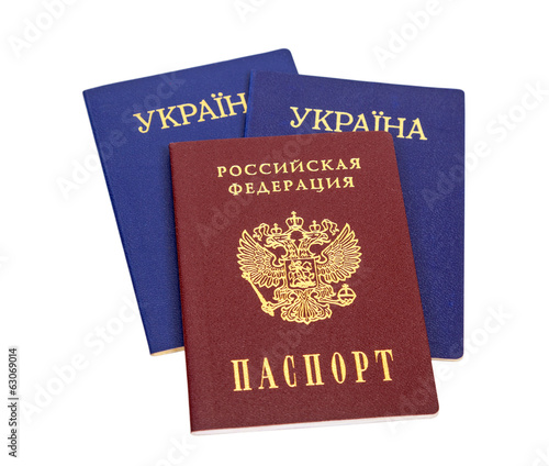 Ukrainian and Russian passports isolated on white background