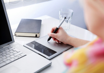 Graphic designer working on digital tablet