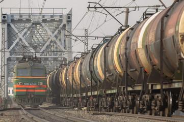 Train travels bridge over the river