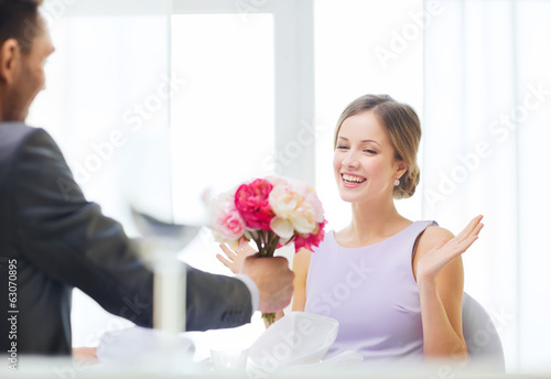 amazed woman recieving bouquet of flowers