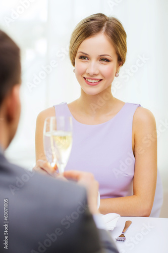 couple with glasses of champagne at restaurant