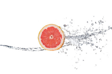 Slice of grapefruit in water splash
