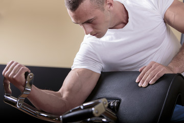 Attractive young man training in the gym