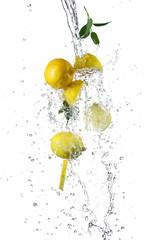 Pieces of lemons in water splash