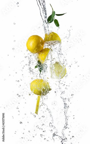 Pieces of lemons in water splash
