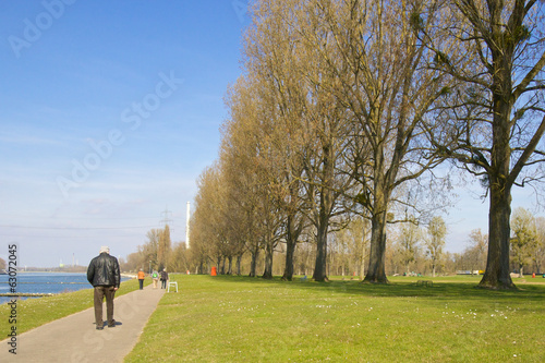 Senior walking along the River Rhine